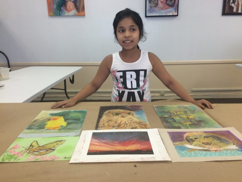 Sarika with her painting